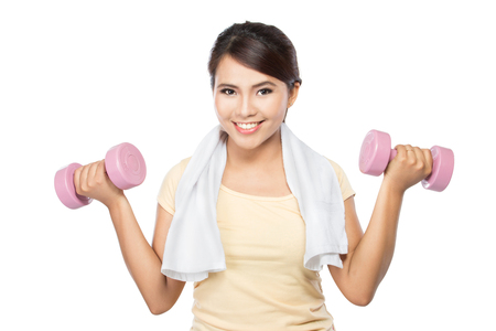 portrait of pretty young woman using dumbbells during exercising photo