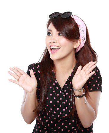 portrait of young casual woman posing excited in studio over white background photo