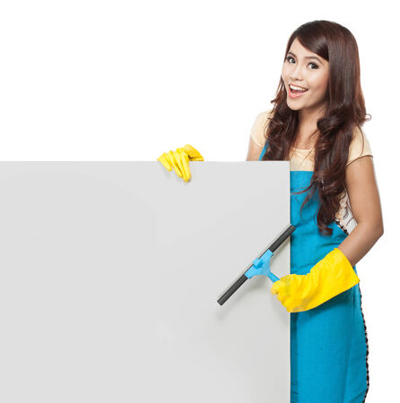 bright housekeeping: Cleaning service woman presenting a blank board and hold a duster