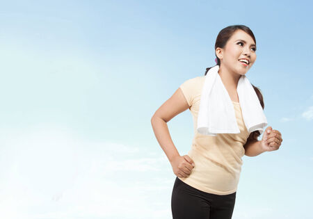 Portrait of sporty healthy young woman running