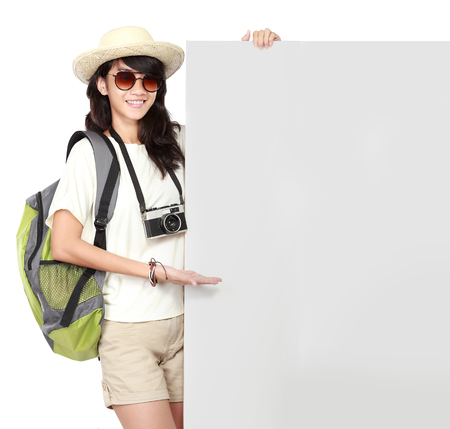 portrait of happy young girl bring backpack hold white banner photo