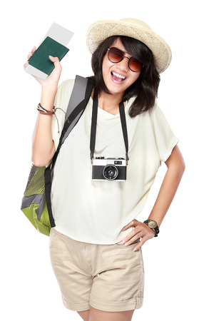portrait of happy young girl bring backpack, boarding pass and pasport photo