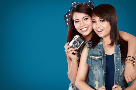 self expression: portrait of attractive two teenage girls pose in camera Stock Photo