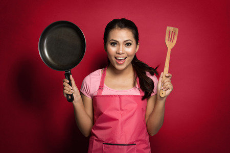spatula: portrait of excited female chef or house wife ready to cook Stock Photo