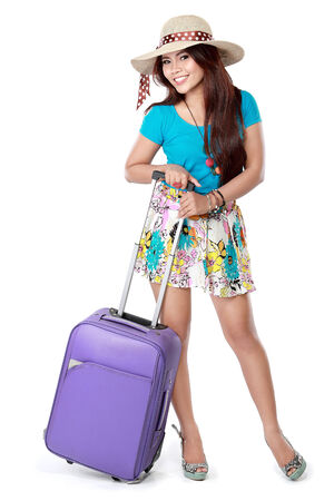 portrait of happy young girl bring suitcase and smile photo