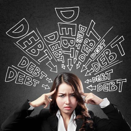 bills: Unpaid. concept of a business woman thinking about her debt