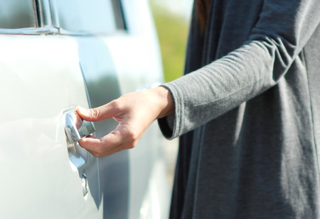 close up portrait of woman hand try to open the car door photo