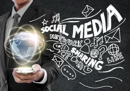 Businessman presenting global network social media concept photo