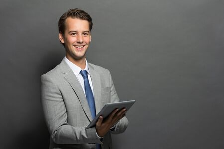 portrait of young businessman using tablet computer photo