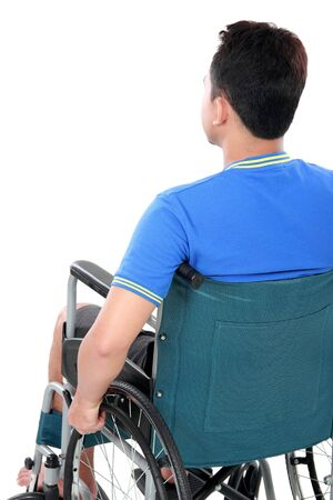 back view of injured man in wheelchair photo