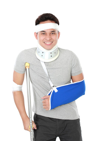 portrait of young man wear sling arm and crutch