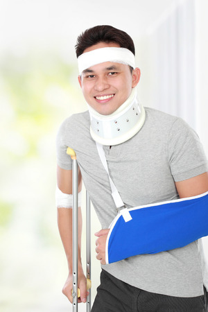 portrait of handsome injured young man but still feel happy