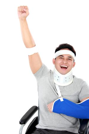portrait of cheerful injured young man raise his hand