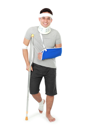 crutch: full length portrait of  injured young man on crutch