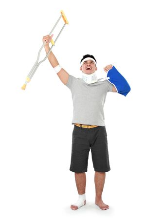 hold up: full length portrait of injured young man hold up his crutch