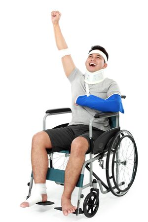 full length portrait of cheerful injured young man raise his hand photo
