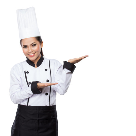 chef uniform: house wife or chef showing and presenting. Woman chef isolated on white background.