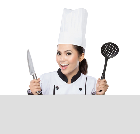 Chef showing blank sign. Woman chef, baker or cook smiling happy holding blank white paper sign isolated on white background photo