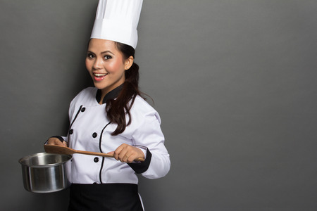 portrait of excited female chef ready to cook Stock Photo