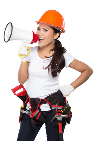 crescent wrench: portrait of young asian woman with tool. holding a megaphone isolated over white background