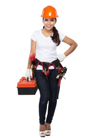 red metal: portrait of young asian woman with tool box isolated over white background