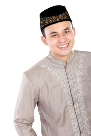 spiritually: handsome muslim man smiling and posing on white background