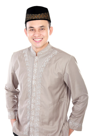 handsome young man wearing muslim dress posing on white background photo