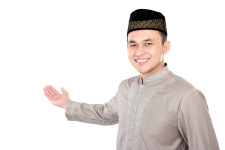 skull cap: portrait of handsome young muslim man present the copy space