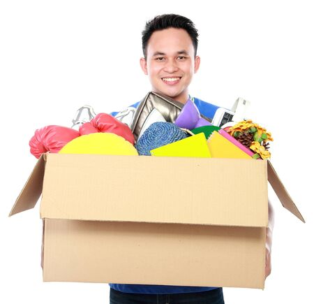 man carrying box: front view portrait of handsome young man carrying box full of stuff on white background