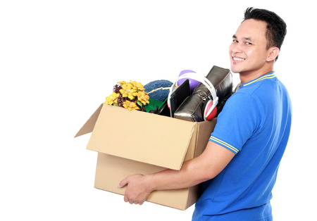 man carrying box: side view portrait of handsome young man carrying box full of stuff on white background