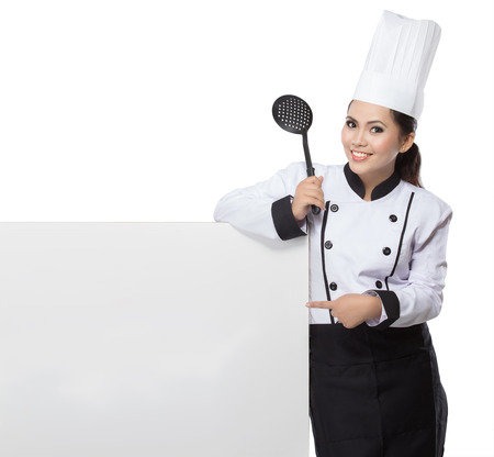portrait of young  woman Chef hold spatula and blank board