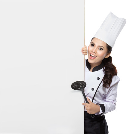 portrait of young  woman Chef hold spatula and blank white board