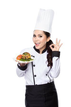 culinary skills: portrait of beauty woman Chef hold a plate and presenting dessert