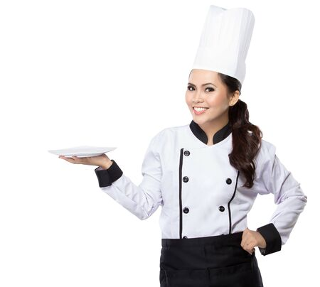 copyspase: Portrait of young woman chef showing blank area for sign or copyspase
