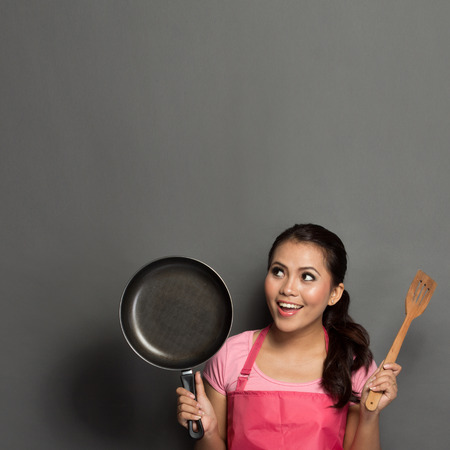 portrait of female chef or house wife ready to cook Standard-Bild