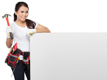 protective workwear: portrait of Female Construction Worker With Toolbelt hold a white paper