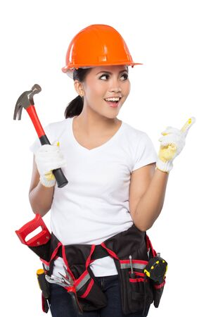 savety: A woman wearing a  tool belt full of a variety of useful tools and pointing up Stock Photo