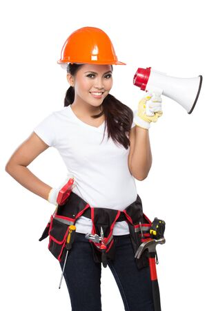 savety: portrait of Female Construction Worker With Toolbelt hold a megaphone