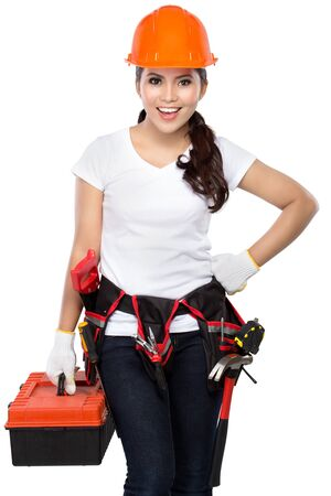 savety: female wearing working clothes with toolbelt holding toolbox isolated on white