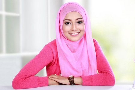 portrait of beautiful young woman wearing hijab