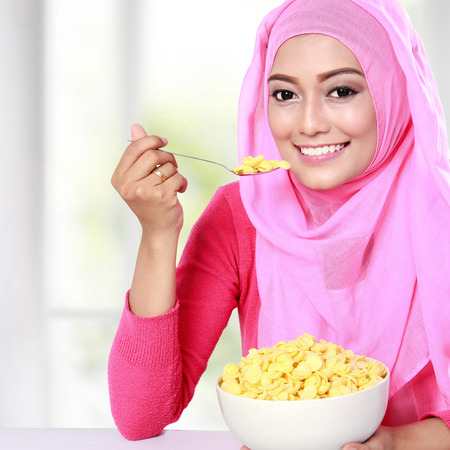 portrait of beautiful young woman had a cereal for breakfast photo