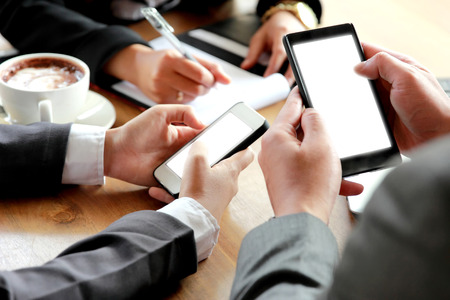 portrait of group of business people using smartphone Stock Photo