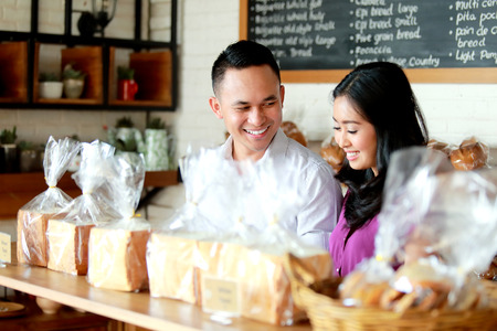 portrait of young couple at bakery shop