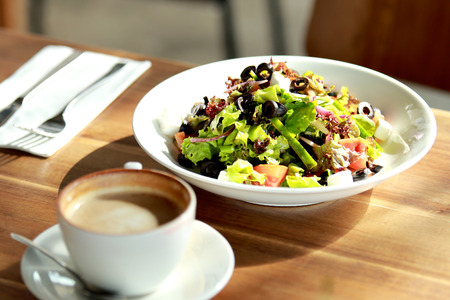 western food: portrait of healthy salad and a cup of coffee for lunch Stock Photo