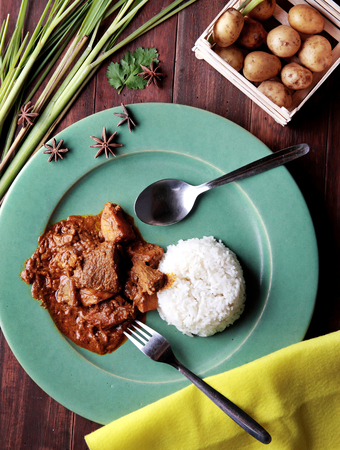 portrait of massaman curry served with rice photo