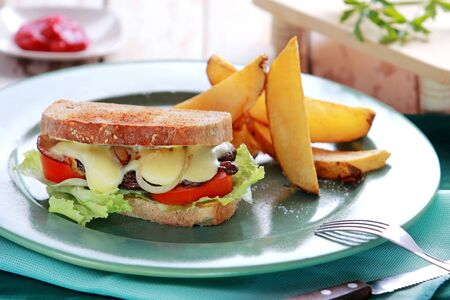 grilled potato: portrait of beef cheese sandwich served with grilled potato
