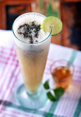saver: a glass of hangover saver juice with honey