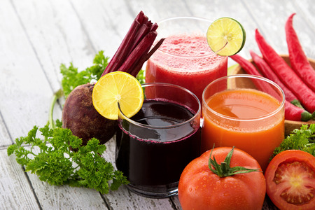 portrait of glasses with vegetable juices. beetroot juice, tomato juice, chili juice