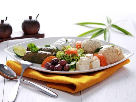 greek food: full length portrait of Greek vegetarian food mix pikilia with hummus, tzatziki, feta cheese, dolmades and olives