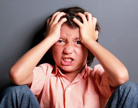 close up portrait of expression of little boy feel stress photo